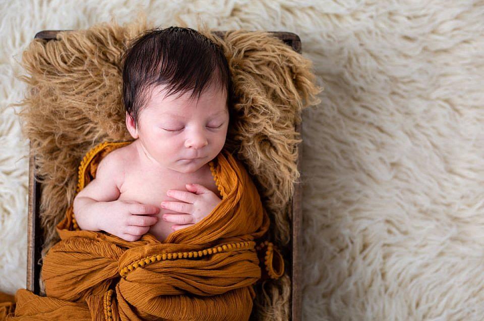 Séance photo pour nouveau-né et sa famille